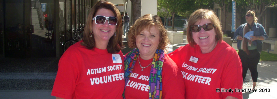 Judy Mark, Caroline Wilson and Emily Iland in red Autism Society T-Shirts