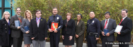 A large group of people from the Autism Society of Los Angeles and LAPD pose at an awards ceremony
